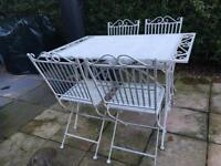 Wrought iron garden table and 4 matching chairs (folding)