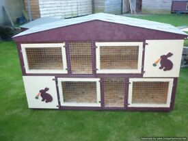 two separate 6ft long rabbit/guinea pig hutches as one hutch