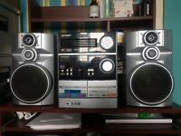 5 tier CD changer with powerful speaker system. Very good condition.