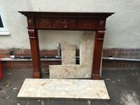 Dark wood effect fireplace with light marble hearth