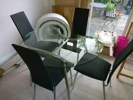 Beautiful glass circular table from Heals together with matching Heals chairs