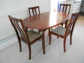 Dining table and four chairs, dark wood, extendible