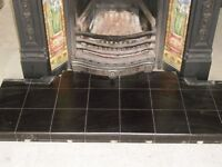 Cast Iron fireplace with black tiled hearth.