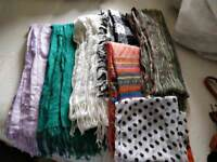 7 womens scarfs and 5 belts.