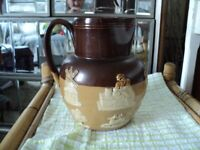 royal doulton lambeth jug height 20 cms slight chip in top but unseen in display
