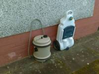 Caravan water and waste cintainers