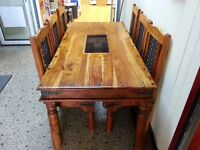 Lovely large India solid wood dining table and 6 chairs. very strong and heavy.