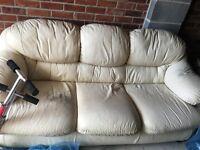 Three seater cream leather sofa
