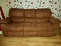 Reclining sofa and reclining armchair