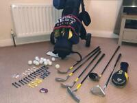 Kids golf clubs and gold trolley