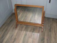 A light oak framed freestanding swing mirror.