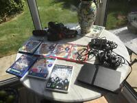 PlayStation 2 with games and controllers