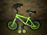 Kids bike. Apollo marvin the monkey bike. Comes with stabilisers. Ideal for a first bike.