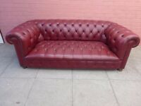 A Cherry Red Leather Chesterfield Buttoned Sofa Settee