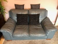 Two-seater blue grey leather sofa 5ft 4in long (1.62m) 3ft 2in deep (0.95m) £120 ONO