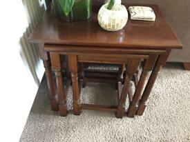 Nest of three side tables. Solid wood