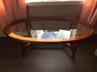 Retro coffee table oval table with glass top very good condition for age