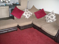 LEFT HAND CORNER SOFA IN VGC BROWN LEATHER BASE AND ARMS.FABRIC SEATS.AND FOOTSTOOL.