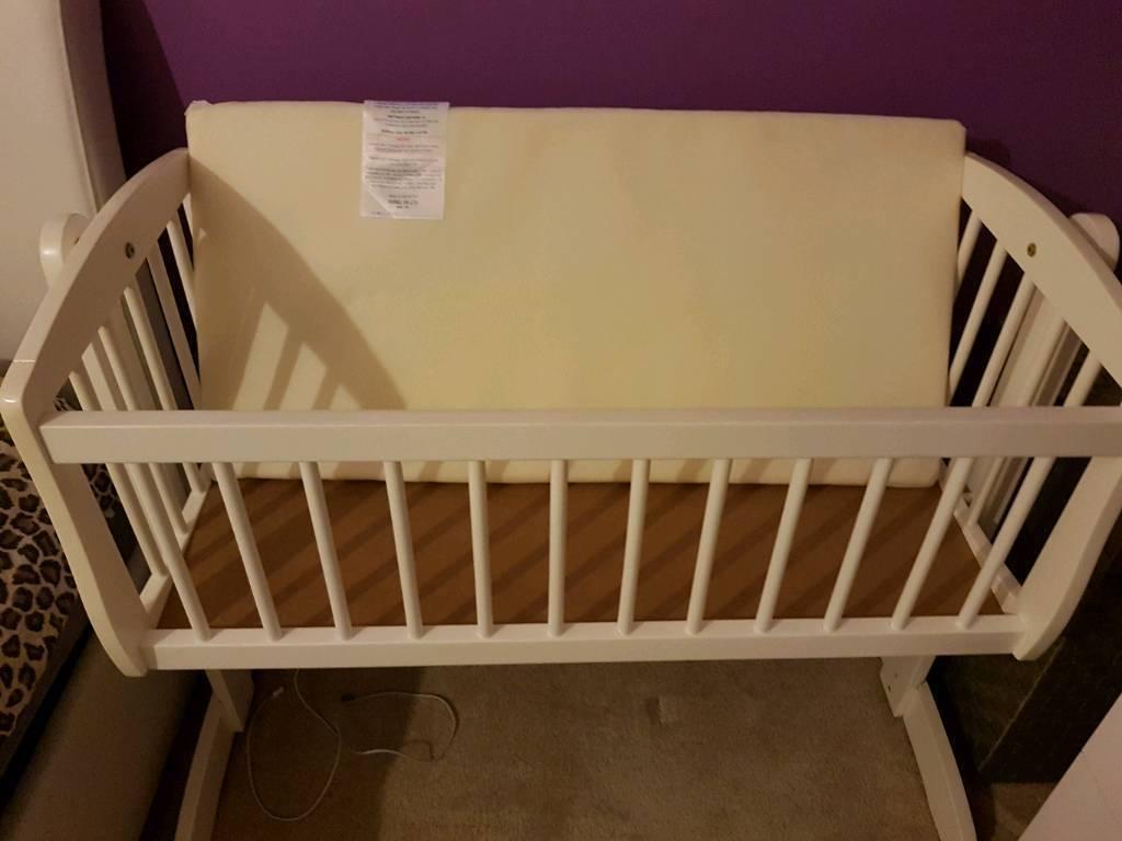 White baby crib.
