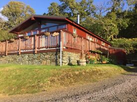 Holiday Lodge set in native woodland and near ferry links and the popular village of Tarbert