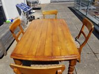 Heavy solid oak table and 4 chairs.