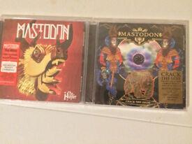 Two Mastodon cds, unopened.
