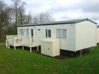 WOW, £3000 off this caravan on a 12mth site,includes decking,storage box,site fees,insurance &rates