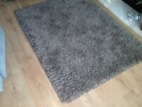 Dark brown rug 160cms ×120cm very good condition bourght from Carpet World smoke pet free home
