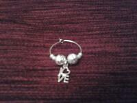 50 wine glass charms. silver so will complement any colour scheme.