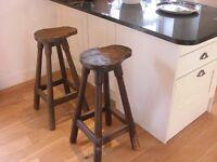Two solid oak rustic bar stools.