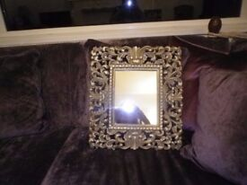 Beautiful small gilt ornate mirror never used, 17 inches by 15 inches