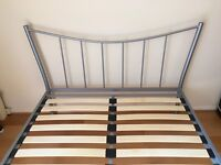 Metal double bed frame, without mattress.