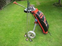 Matched set of Wilson Golf Clubs, bag and folding trolley