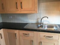 Fitted kitchen and worktops including oven, hob and sink
