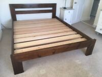 Contemporary, sturdy, dark wood king size bed from Warren Evans in London