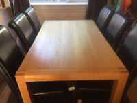 OAK TABLE AND 6 LEATHER CHAIRS