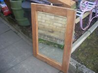 HEAVY WOODEN MIRROR . £20