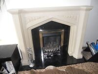 Stone effect fire surround with black marble insert