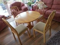 Round pine dining table with 4 chairs