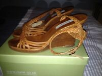 Tan sandals size 7 in good condition .