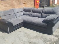 Very nice Brand New black and grey cord corner sofa. 2 corner 1. can deliver