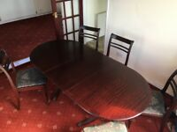 Offers: Beautiful hardwood dining table and chairs 5 leafed mahogany
