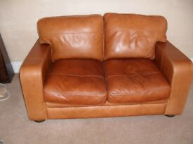 PAIR OF TWO SEATER BROWN LEATHER SOFAS.