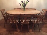 Pine oval dining table and 8 chairs