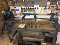 Used Cornet Major Woodworking Lathe With accessories shown and bench.