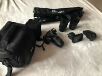 Nikon D5100, lenses, tripod, flash, and bag