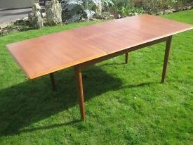Vintage teak Danish dining table by Dyrlund seats 8