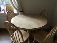 Argos country style round dining tables and 4 chairs