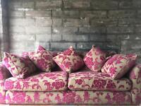 Beige and pink large 3 seater sofa. With scatter back cushions.