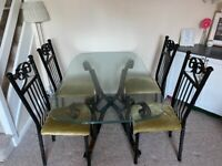 Glass top dining room table and 4 chairs